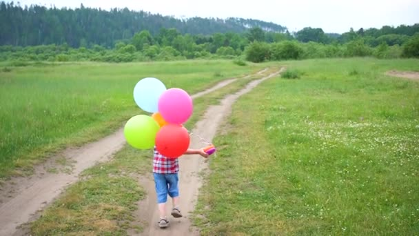 Happy little baby, fun running around with balloons. Outdoor recreation. Celebration and fun.Childs birthday