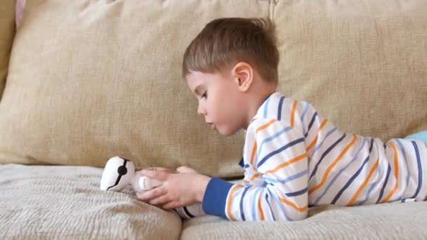 A child in the living room playing with a robot toy. Handsome child. Baby face , close-up.