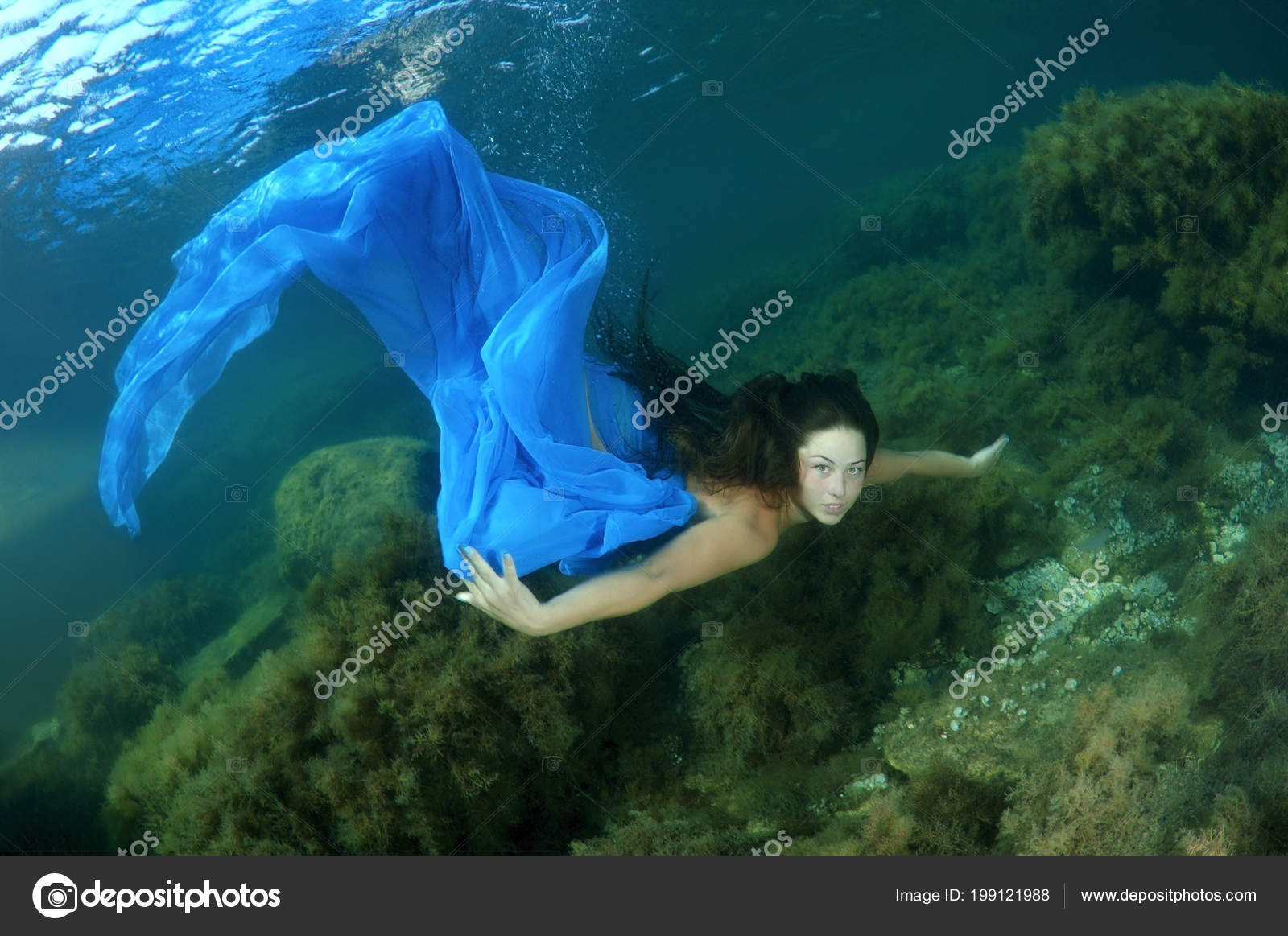 f5d2f43c34 Young Woman Blue Dress Swims Underwater Black Sea Crimea — Stock Photo