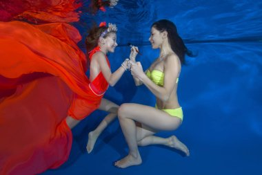 Makeup woman doing make-up the girl under water,
