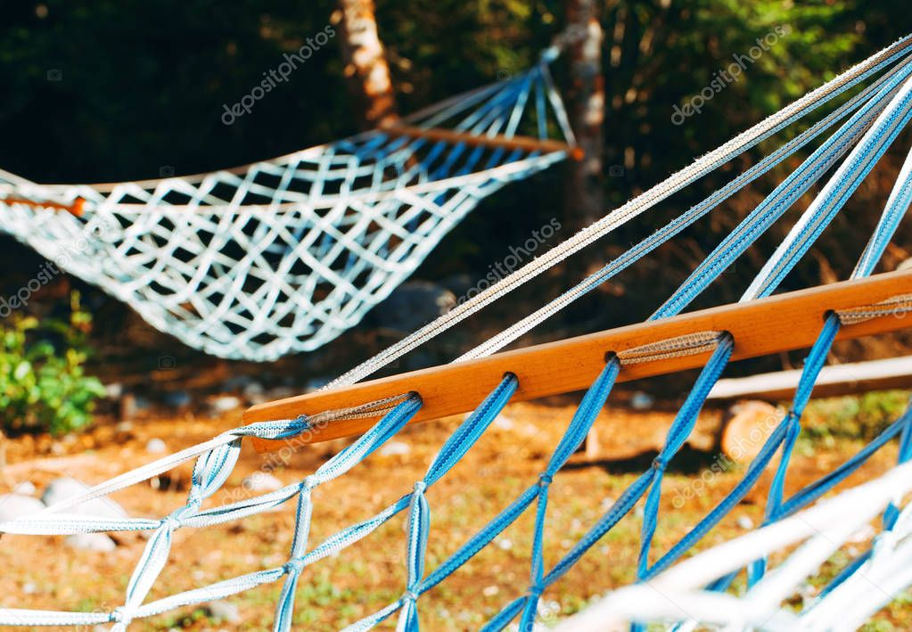 Two close-up hammocks peaceful summer valley scene.