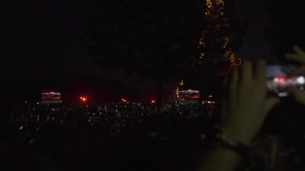 Crowd of People shooting and taking photo of the Eiffel Tower in Paris France