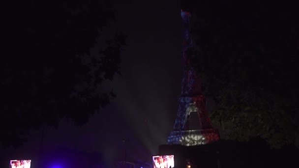 Crowd of People shooting and taking photo Tricolor at the Eiffel Tower at night