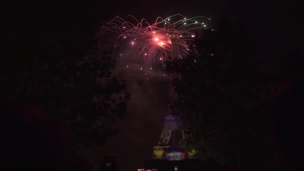 Fireworks in night sky. 3D projection show colorful lights at Eiffel Tower.