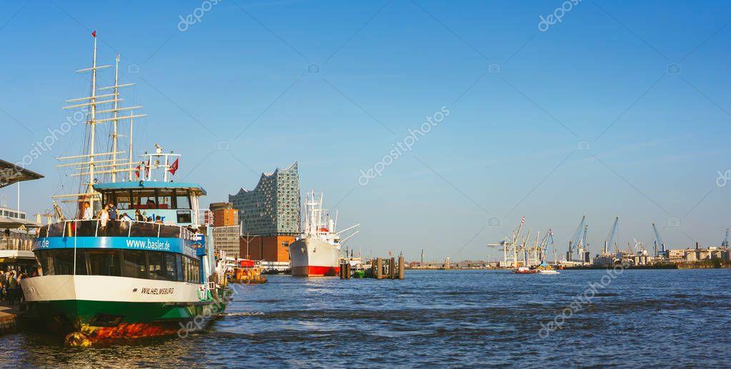 HAMBURG, GERMANY - April 18, 2018: St Pauli Landungsbrucken landing place in Port of Hamburg between the lower harbour and Fish Market on Elbe river