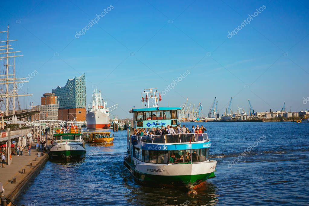 HAMBURG, GERMANY - April 18, 2018: St Pauli Landungsbrucken landing place in Port of Hamburg between the lower harbour and Fish Market on Elbe river