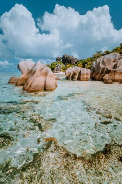 Anse Source dArgent - Dreamlike, paradise beach with unique bizarre granite boulders, shallow lagoon water. La Digue island, Seychelles. Vertical shot
