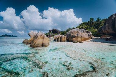 Impressive cloudscape above Anse Source DArgent tropical beach, La Digue Seychelles. Luxury exotic travel concept