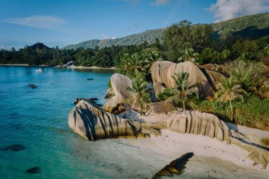 Aerial drone view of unique Anse Source DArgent tropical beach, La Digue Seychelles. Luxury exotic romantic travel honeymoon concept