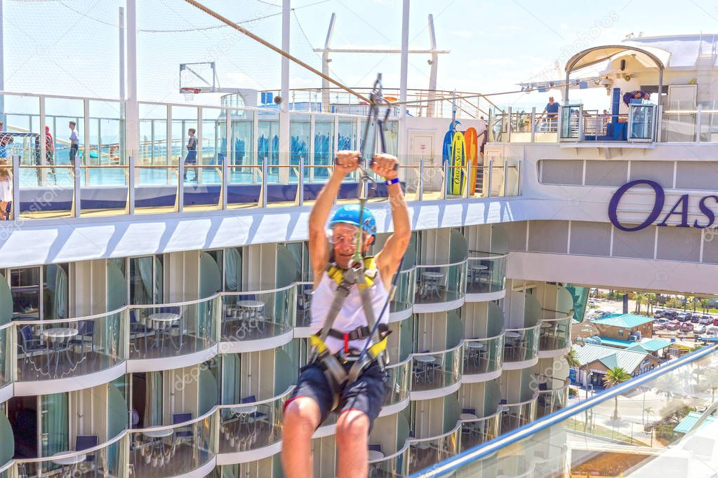 Ft. Lauderdale, USA - 30 April, 2018: The passenger flying at zip line at cruise liner or ship Oasis of the Seas by Royal Caribbean