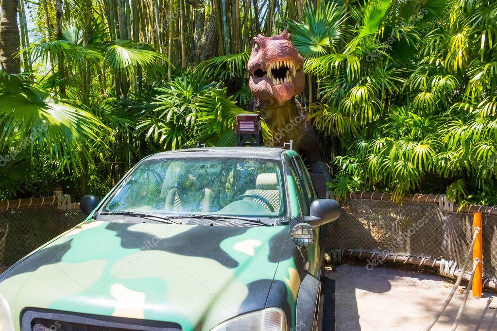 Orlando, Florida - May 09, 2018: Jurassic Park dinosaur and jeep at Universal Studios Islands of Adventure theme park