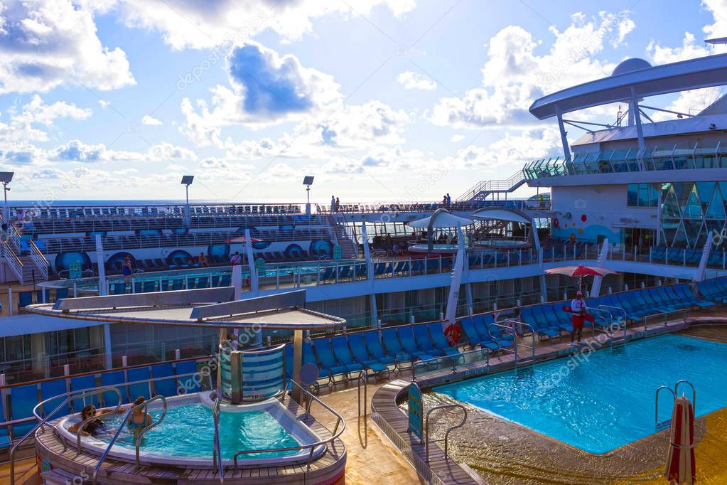 Cape Canaveral, USA - April 30, 2018: The upper deck with childrens swimming pools at cruise liner or ship Oasis of the Seas by Royal Caribbean