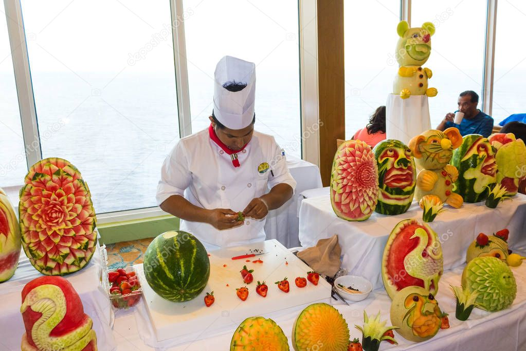 Cape Canaveral, USA - May 06, 2018: The chef presenting a culinary show on a cruise ship Oasis of the Seas by Royal Caribbean at Cape Canaveral, USA on May 06, 2018