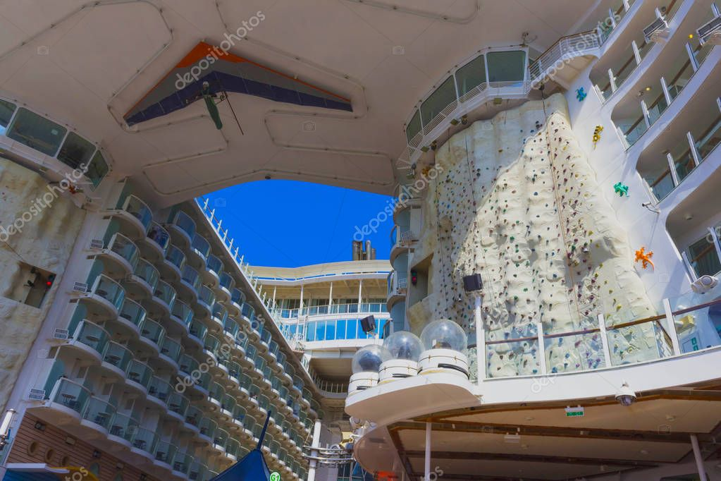 Cape Canaveral, USA - April 29, 2018: The climbing wall at cruise liner or ship Oasis of the Seas by Royal Caribbean docked in Cape Canaveral, USA on April 29, 2018.