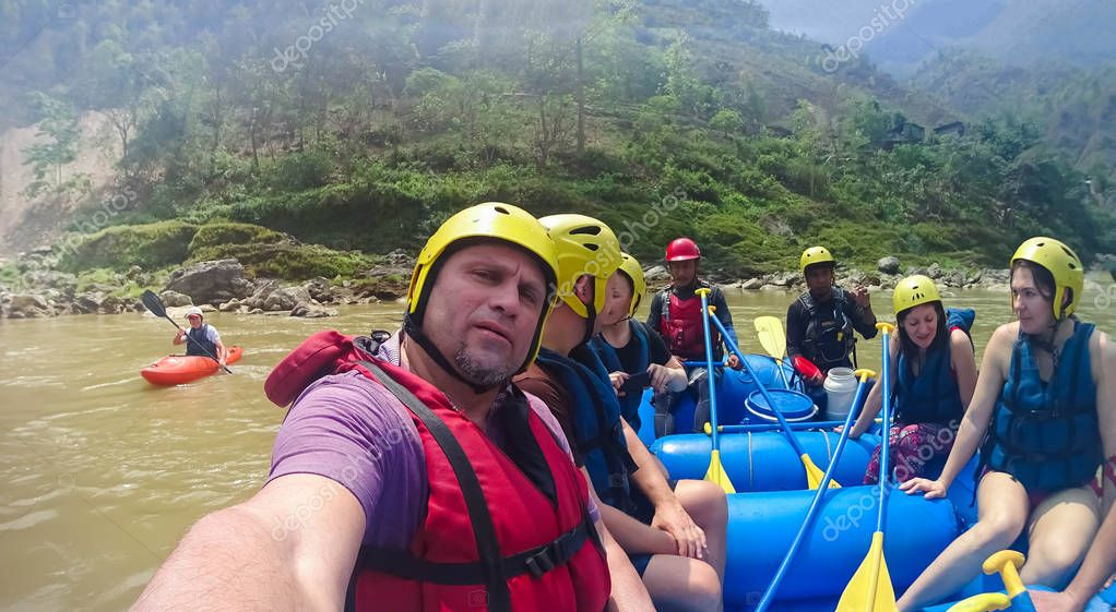 Bhote Koshi river, Nepal - April 09, 2018: The people sitting at boat at rafting on the Bhote Koshi in Nepal. The river has class 4-5 rapids.
