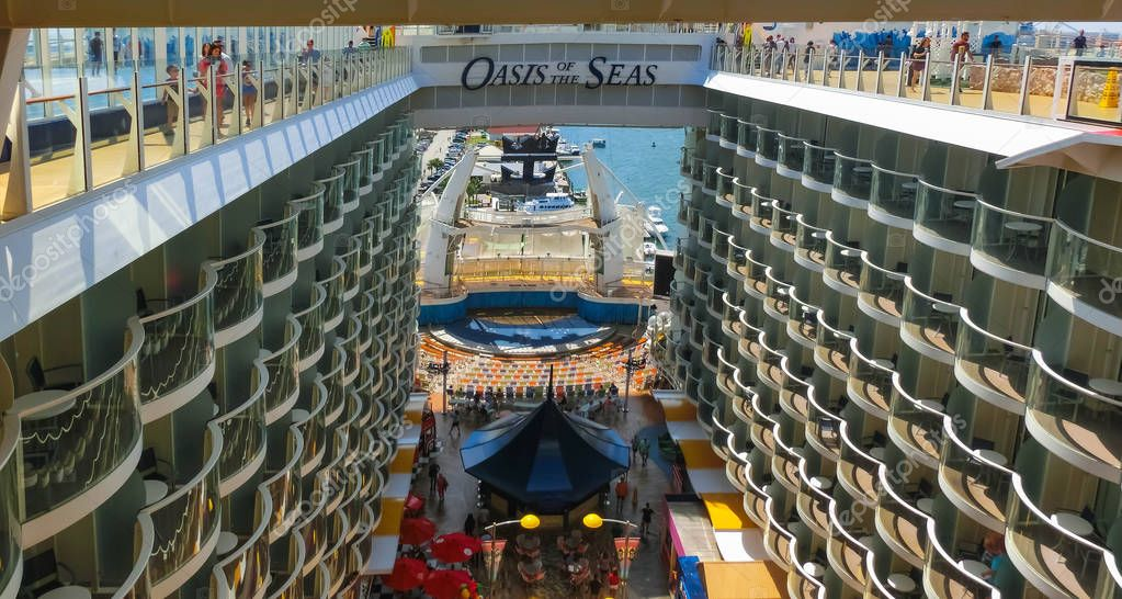 Cape Canaveral, USA - April 29, 2018: The Boardwalk, Aqua Theater amphitheater, climbing wall at cruise liner Oasis of the Seas by Royal Caribbean docked in Cape Canaveral, USA on April 29, 2018.