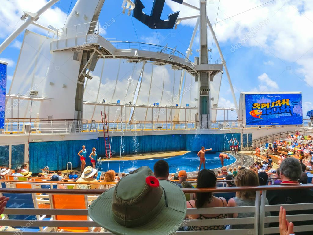 Cape Canaveral, USA - May 03, 2018: The people sitting at show at Aqua Theater amphitheater at cruise liner Oasis of the Seas by Royal Caribbean