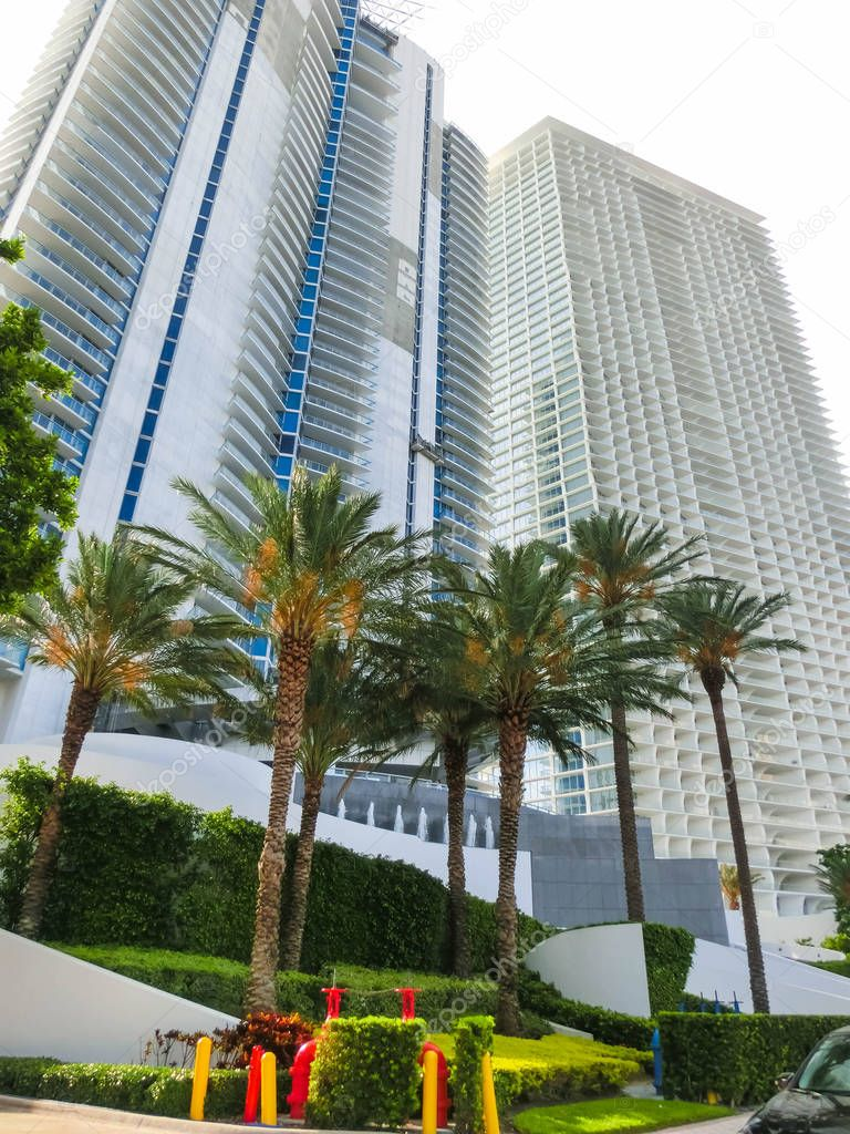 Miami, Usa - May 07,2018: Modern apartment buildings with palm trees at Collins Avenue