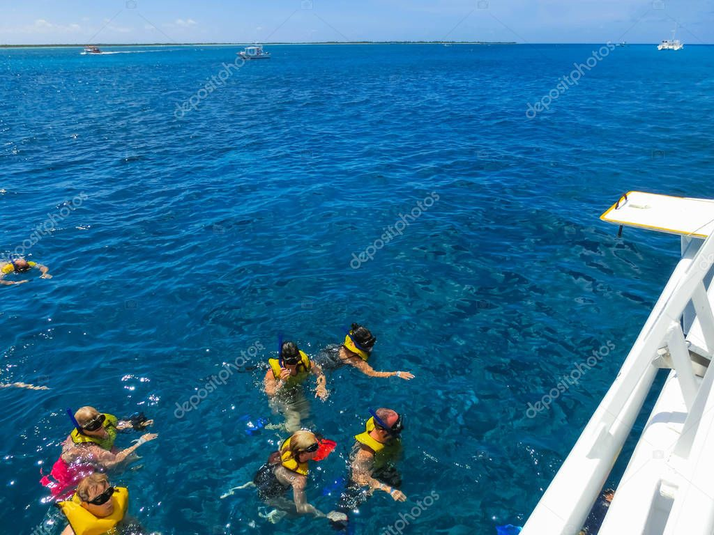 Cozumel, Mexico - May 04, 2018: Group of friends snorkeling together on a party boat tour of the Carribean Sea at Cozumel, Mexico on May 04, 2018