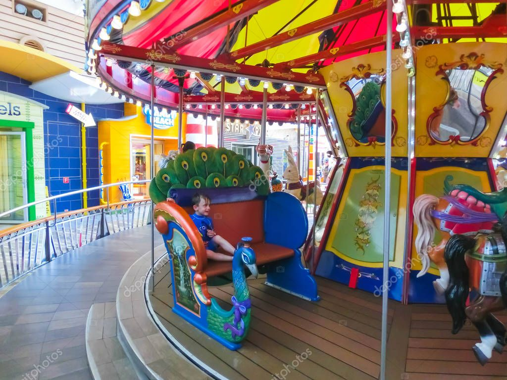 Cape Canaveral, USA - April 29, 2018: The French merry-go-round Boardwalk at cruise liner Oasis of the Seas by Royal Caribbean docked in Cape Canaveral, USA on April 29, 2018.