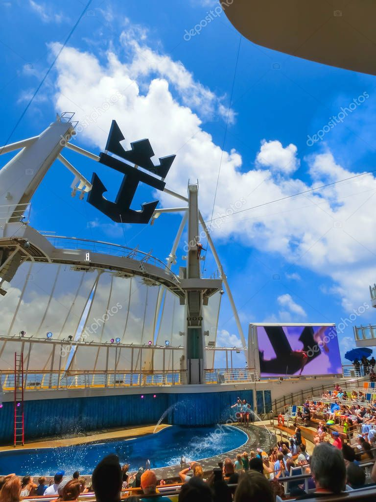 Cape Canaveral, USA - May 03, 2018: The people sitting at show at Aqua Theater amphitheater at cruise liner Oasis of the Seas by Royal Caribbean docked in Cape Canaveral, USA on May 03, 2018