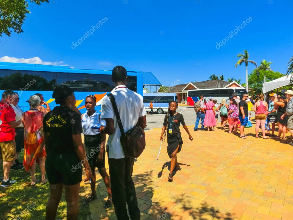 Falmouth, Jamaica - May 02, 2018: The tourists are preparing for the beginning of a bus tour of the island