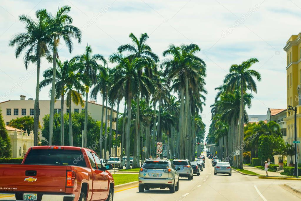 WEST PALM BEACH, Florida -7 May 2018: The road with cars at Palm Beach, Florida, United States