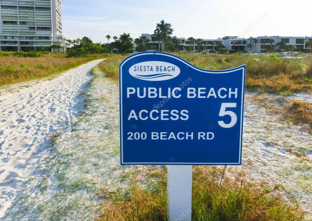 Siesta Key, USA - May 11, 2018: Siesta Key welcome sign with beach