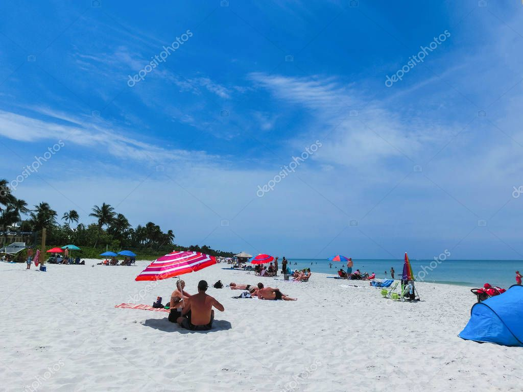 Naples, USA - May 8, 2018: Tourists enjoying the Vanderbilt beach in Naples, Florida.