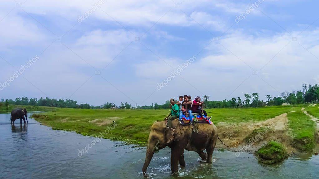 CHITWAN, Nepal - April 09, 2018: Elephant safari in Chitwan National Park, Nepal