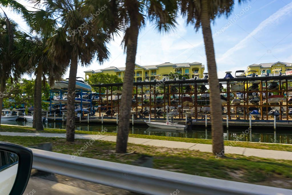 Siesta Key, USA - May 11, 2018: speed motor boats are stapled in a garage system in the prestigious harbor