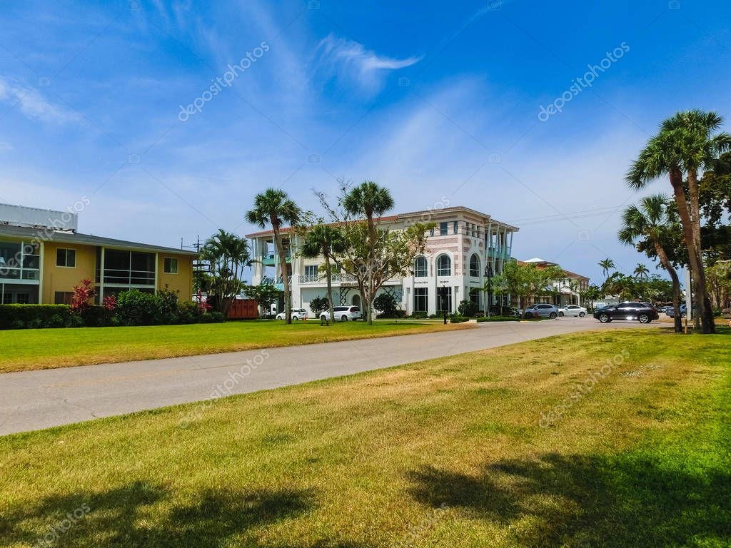 Naples, USA - May 8, 2018: Exterior of a two-story modern resort building in Naples, Florida