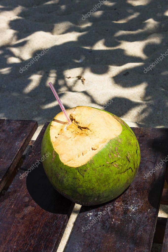 Green coconuts with drinking straw