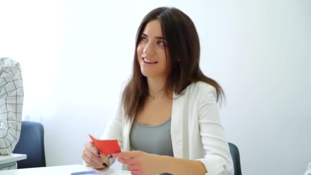 smiling positive female student answering teacher in classroom