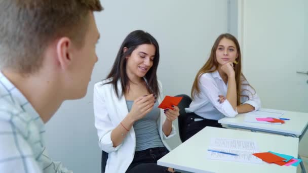 group of high school students sitting in classroom and having conversation practice