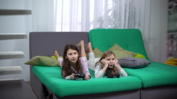 kids playing with game consoles