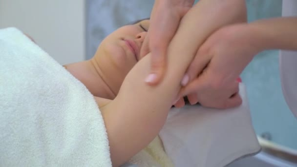 female hands doing anti cellulite massage on shoulder of young woman