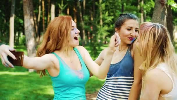 selfie time of female friends covered with colorful powder after Holi festival