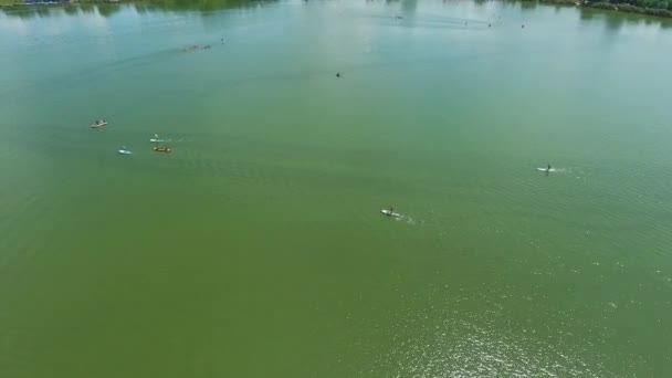 aerial of water sports competition with kayakers and stand up paddle boarders
