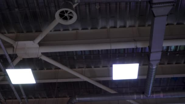 pipes of hvac system hang on ceiling of big mall