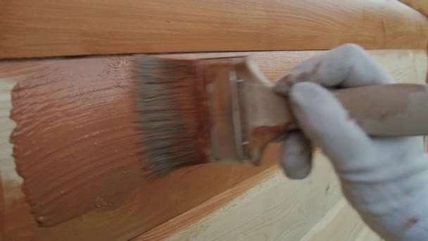 Wooden wall painting with a brush with the brown color