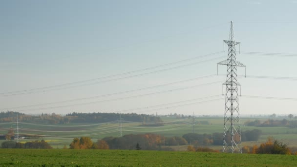 Power lines stretching off into the distance in a rural setting
