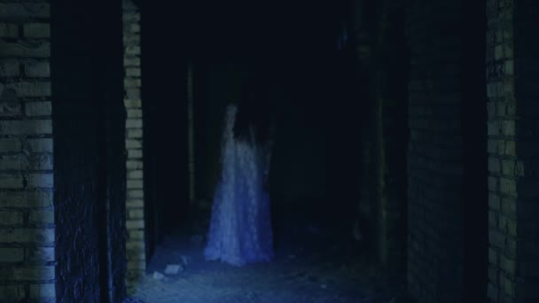 Creepy zombie girl wandering in abandoned haunted castle, attack of undead