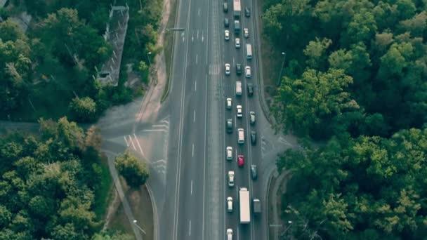 Massive traffic jam on suburban road, vehicles moving slowly, transport system