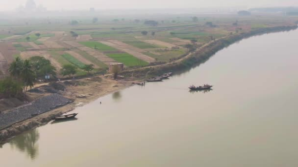 Vrindavan, India - March 02, 2019: People on Ganga river, 4k aerial drone