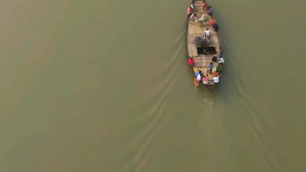 Vrindavan, India - March 02, 2019: People on Ganga river, 4k aerial drone