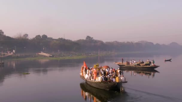Mayapur, India - March 19, 2019: Hare Krishna pilgrims procession in a boat by river