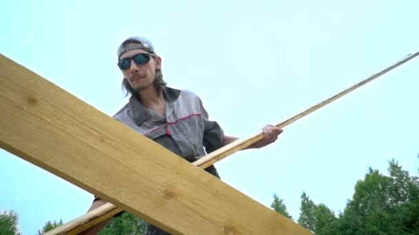 the worker is building the roof