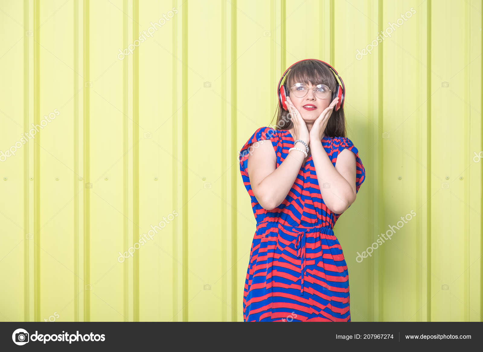 Beautiful Woman Listening Music Isolated Yellow Metal Wall