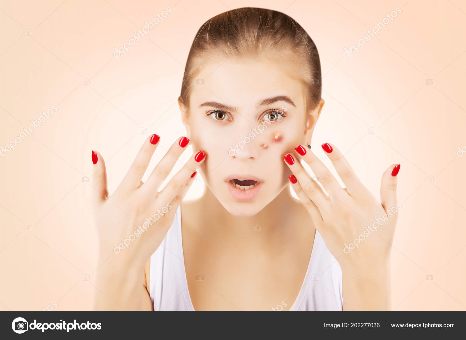 girl funny disgusted face examines her pimples stock photo
